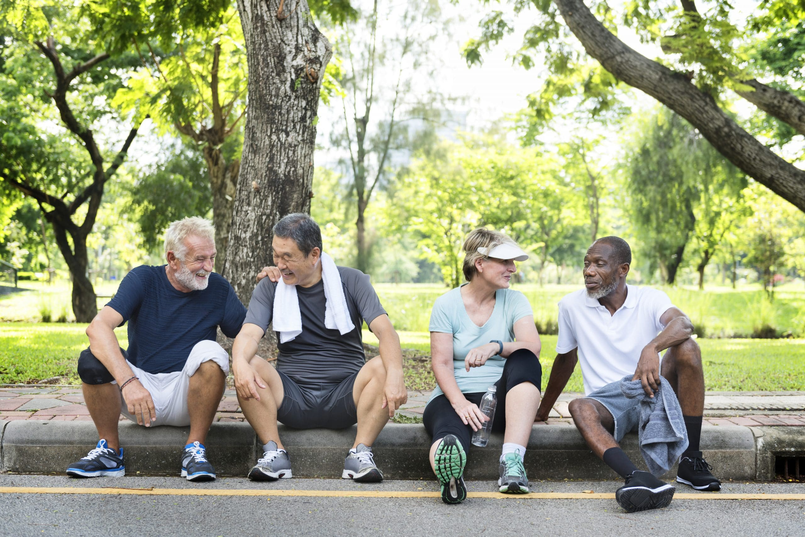 Group of senior friends relaxing together after an excercise